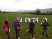 kids using bow and arrows